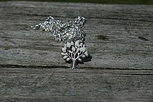 Breast milk jewelry wikipedia a filled tree of life breast milk pendant mozeypictures Choice Image