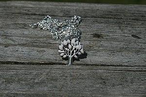 Breast milk jewelry - A filled tree of life breast milk pendant.
