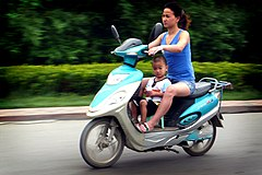 Mother & son on a electric motorbike in china.jpg
