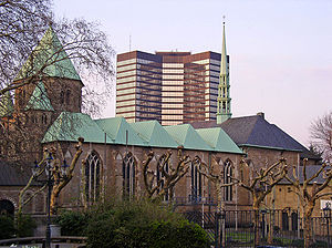 "Essen Abbey - Essen Cathedral (""Essener Münster""), former abbey church, overshadowed by the City Hall of modern Essen."