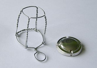 Muselet - An opened muselet with cap