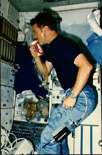 STS-51-F - An astronaut drinks soda in space