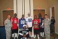 NFL players at Wounded Warrior luncheon 2013.jpg