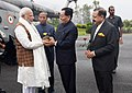 Narendra Modi being welcomed by the Governor of Sikkim, Shri Ganga Prasad, the Chief Minister of Sikkim, Shri Pawan Kumar Chamling and the Minister of State for Development of North Eastern Region (IC).JPG