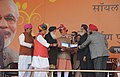 Narendra Modi giving Krishi Karman Award to the Chief Minister of Punjab, Shri Parkash Singh Badal at the launch of the 'Soil Health Card Scheme', at Suratgarh, in Rajasthan. The Union Minister for Agriculture.jpg