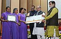 Narendra Singh Tomar conferred the National Awards on Best Performing Women Self-Help Groups and Village Organisations under DAY-NRLM, at a function, in New Delhi.jpg