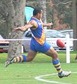 Nauruan player kicking.jpg
