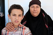 Nayfa and grandson Mahmoud, aged 11, at an IRC clinic in Ramtha, Jordan (9613473031).jpg