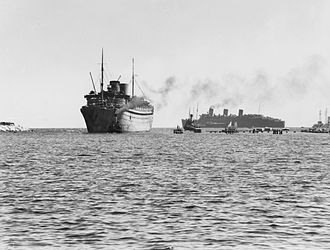 SS Nieuw Amsterdam (1937) - Nieuw Amsterdam entering Fremantle Harbour on 18 February 1943, with RMS ''Queen Mary'' in the background during the two ships' involvement in Operation Pamphlet