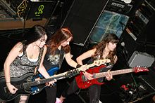 Photograph of three women playing guitar