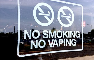 Electronic cigarette aerosol and liquid - A no smoking or vaping sign from the US.