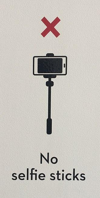 "Selfie stick - A ""no selfie sticks"" sign at the Museum of Brisbane, 2015"