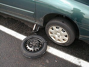 English: Normal tire, compact spare and jack u...
