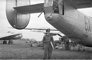 Einar Stang - Einar Stang in front of a B-24 Liberator