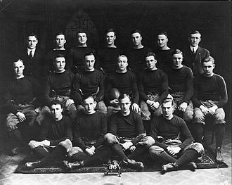 Notre Dame Fighting Irish football - 1913 squad, with Captain Knute Rockne holding ball