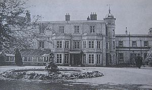 Old Manor Hospital, Salisbury - A view of Finch House from the east showing the main entrance and the statue brought from Bemerton Lodge