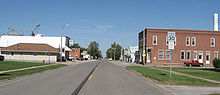 The downtown area of a small town bisected by a highway.