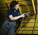 Operating a hand drill at Vultee-Nashville1a35374v (cropped).jpg