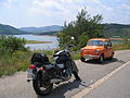 Orange Zastava 750 or 850 and an motorcycle in Macedonia.jpg