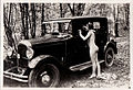 Ostra woman leaning on car.jpg