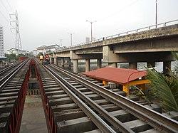 Pandacan railway bridge & Tower 154 of Sucat-Araneta-Balintawak trans linefvf.jpg