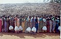People line up to collect the relief supply at Kalapet village near Pondicherry.jpg