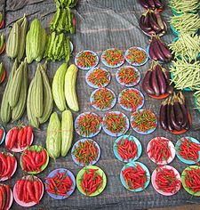 Organic fruits and vegetables at a farmers' market in Argentina Pepperseggplants.jpg