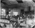 Photograph of five San Francisco Mint employees in the electrolytic refining section. The electrolytic process on... - NARA - 296595.tif
