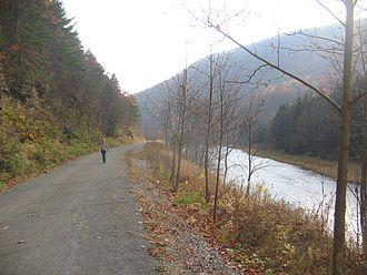 Pine Creek Rail Trail - Hiker on the Pine Creek Rail Trail just north of Blackwell in Tioga County, Pennsylvania.