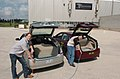 Plugging in Argonne hybrid electric vehicles.jpg