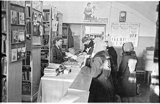 School library - The school librarian supplies children with educational books (Russia, 1959)