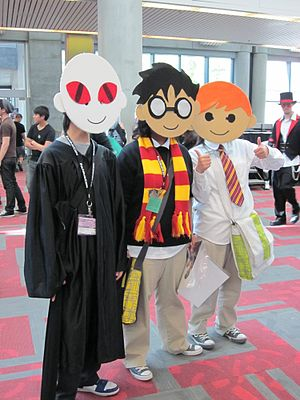 Cosplayers portraying Lord Voldemort, Harry Po...