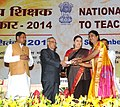 Pranab Mukherjee presenting the National Award for Teachers-2014 to Smt. M V Kusuma, Karnataka, on the occasion of the 'Teachers Day', in New Delhi. The Union Minister for Human Resource Development, Smt. Smriti Irani.jpg