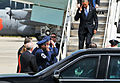 President Barack Obama, on steps, returns a salute to U.S. Air Force Col. Marshall C. Collins, the commander of the 145th Airlift Wing, North Carolina Air National Guard, and Chief Master Sgt. Maurice Williams 140826-Z-FY745-143.jpg