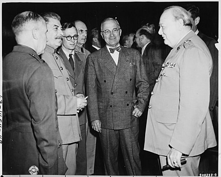 Churchill at the Potsdam Conference, July 1945. President Truman (center) speaks with Soviet Prime Minister Josef Stalin (at left) and British Prime Minister Winston... - NARA - 198775.jpg