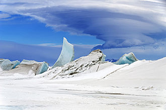 Earth - Lenticular cloud over an ice pressure ridge near Mount Discovery, Antarctica, November 2013