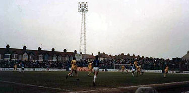 Gillingham (blue shirts) in action in a match from the 1986-87 season Priestfield2.jpg
