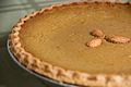 Pumpkin pie with almond decoration, March 2009.jpg