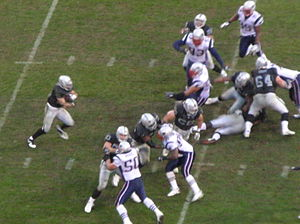 2008 Oakland Raiders season - The Raiders run the ball against the Patriots in the rain