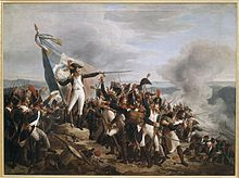 Painting shows a man in a blue uniform with white breeches standing on a mountaintop amid a crowd of soldiers. He gestures dramatically with his sword as he holds a French tricolor. Some of the soldiers are firing downhill.