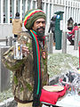 Rasta vendor with hat and glass Obama mug Inauguration 2013.jpg