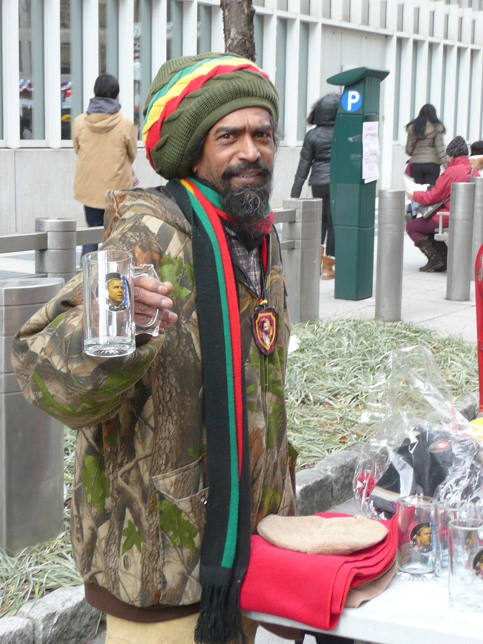 Rasta vendor with hat and glass Obama mug Inauguration 2013