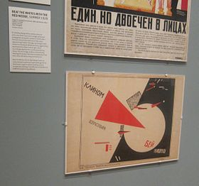 poster with a red triangle entering a white circle