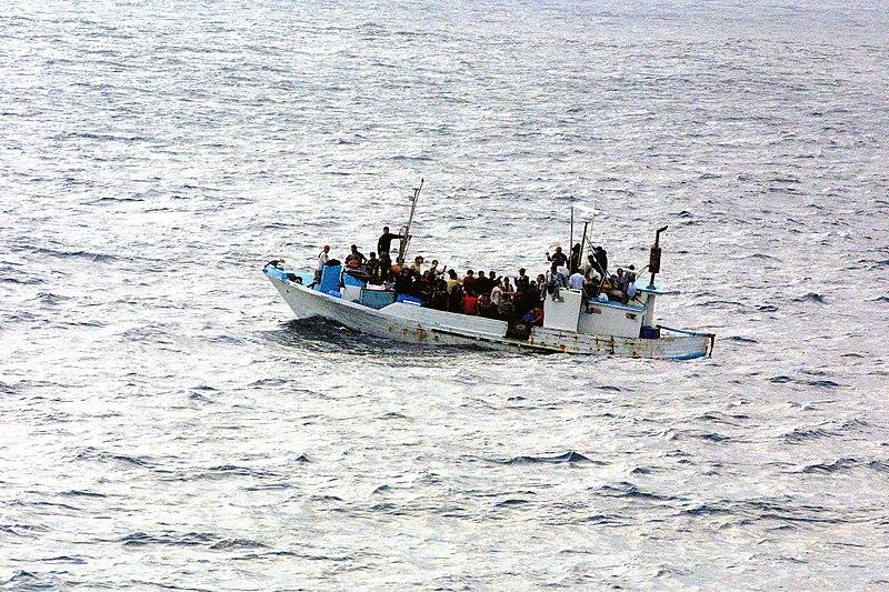 File:Refugees on a boat.jpg