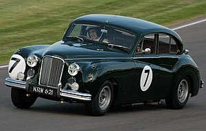 Rowan Atkinson - Atkinson racing in a Jaguar Mark VII M at the Goodwood Revival motor racing festival in England in 2009