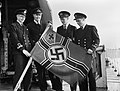 Royal Navy officers aboard the destroyer HMS GARTH with a captured German E-boat ensign at Sheerness, 21 October 1944. A26034.jpg