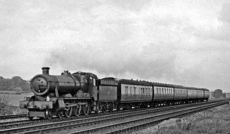 GWR 6959 Class - 6960 Raveningham Hall (now preserved) with an express train, April 1957.