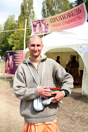Hinduism in Russia - Hare Krishna devotee with books.