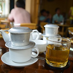 Coffee production in Vietnam - Vietnamese coffee brewing in single-cup filters. In southern Vietnam, a cup of coffee is often accompanied by a cup of hot or cold tea. In the northern regions, this rarely occurs and the coffee is often twice as expensive.