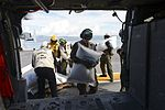 Sailors and Marines load food for delivery onto an MH-60S Seahawk. (30310007382).jpg